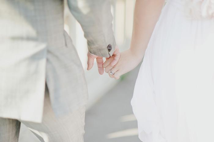 Paris wedding photographer - Newlyweds holding hands