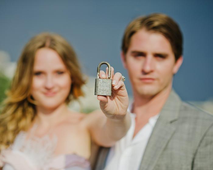 Paris wedding photographer - Newlyweds holding love lock