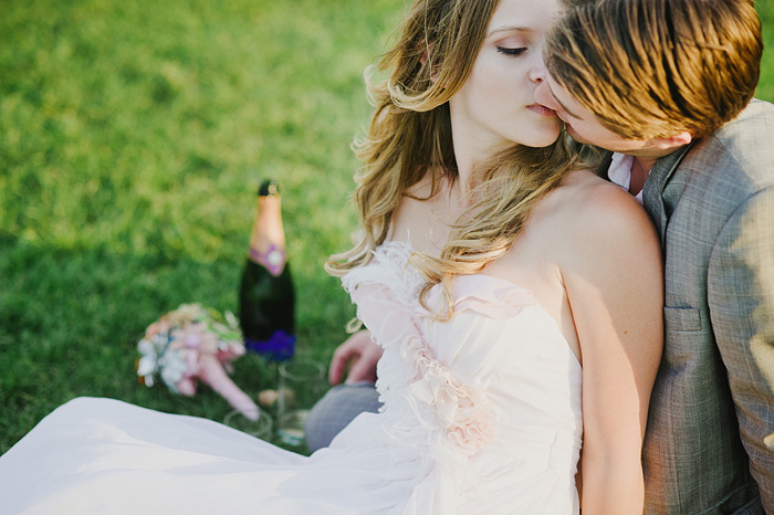 Newlyweds kissing in Champ de Mars - Portland wedding photographer