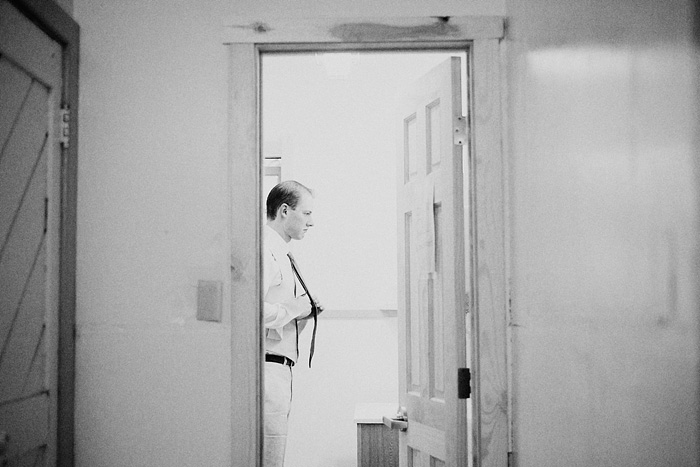 Groom getting ready in the bathroom at Camp Royaneh - Bay Area Wedding Photographer
