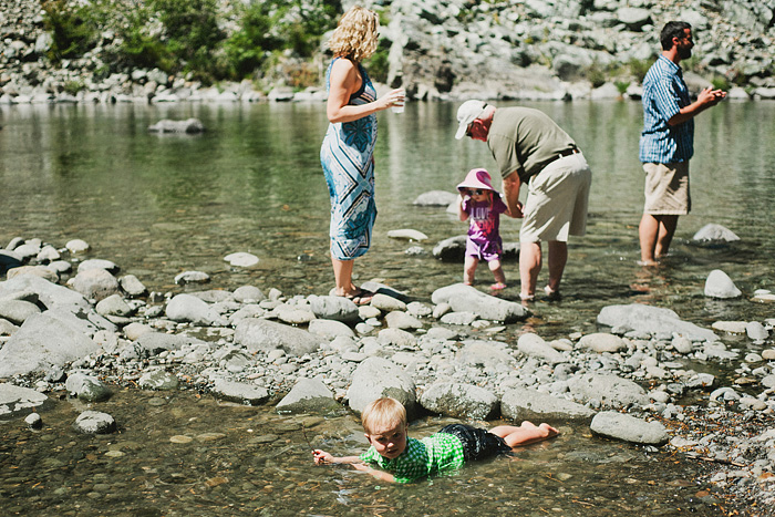 Toddler playing in the water at a Smith River wedding - Gasquet, CA