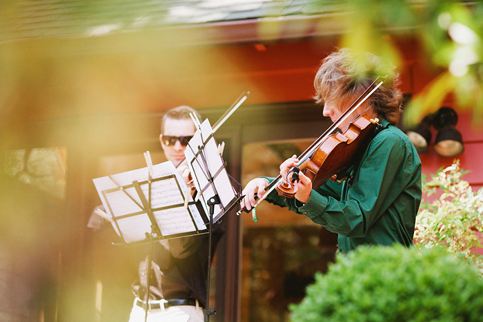 Classical violin duo performing at an intimate backyard wedding - Gasquet, CA