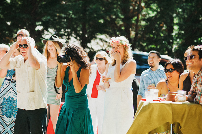 Guests laughing at blindfolded groom - Intimate Backyard Wedding - Gasquet, CA