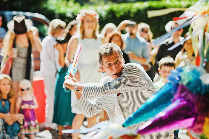 Father of bride destroying pinata - Intimate Backyard Wedding - Gasquet, CA