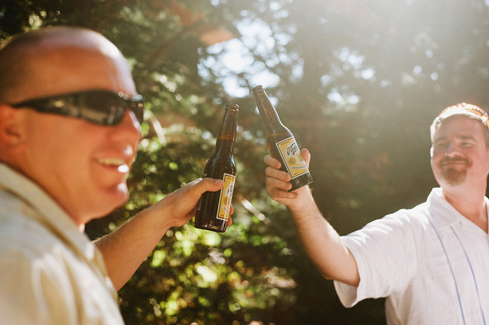 Guests toast with beer bottles - Intimate Backyard Wedding - Gasquet, CA
