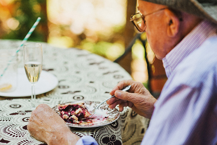 Elderly guest eating berry pie - Intimate Backyard Wedding - Gasquet, CA