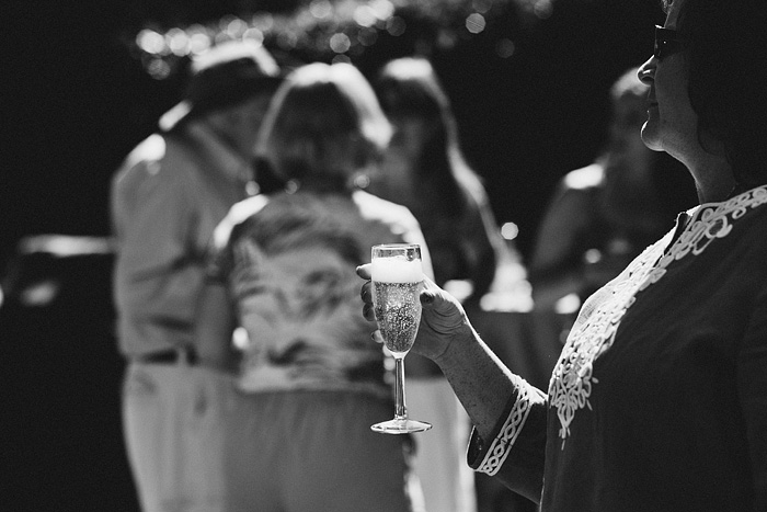 Guest holding a glass of champagne - Intimate Backyard Wedding - Gasquet, CA