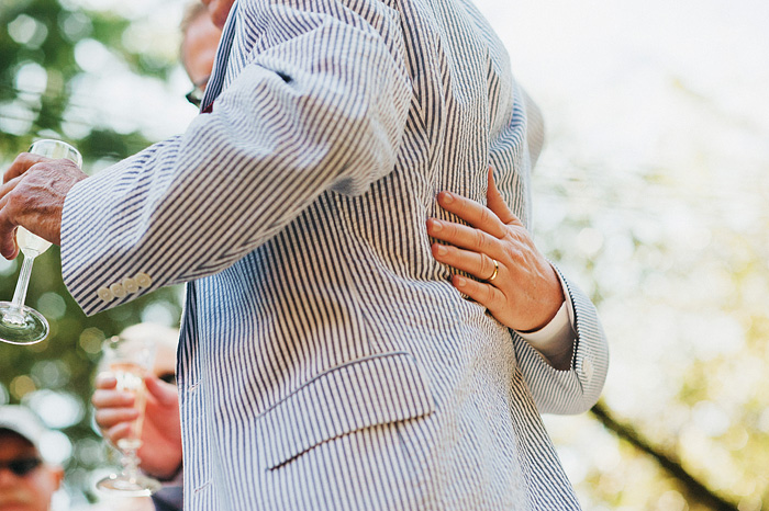 Groom and Father of Bride hugging after toasts - Intimate Backyard Wedding - Gasquet, CA