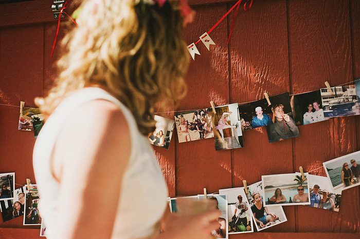 Bride looking at red barn wedding photo montage - Intimate Backyard Wedding - Gasquet, CA