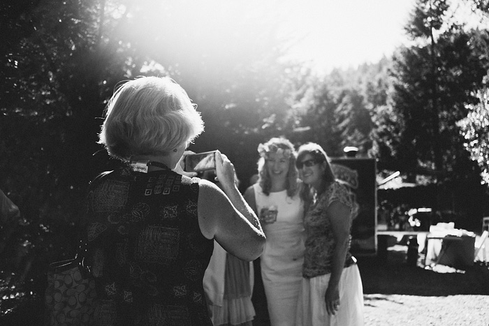 Bride getting her picture taken with guests - Intimate Backyard Wedding - Gasquet, CA