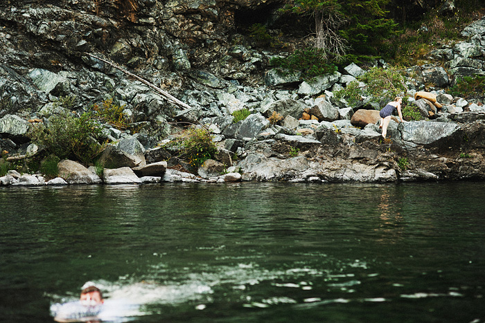 Bride climbing rocks on the Smith River - Intimate Backyard Wedding - Gasquet, CA
