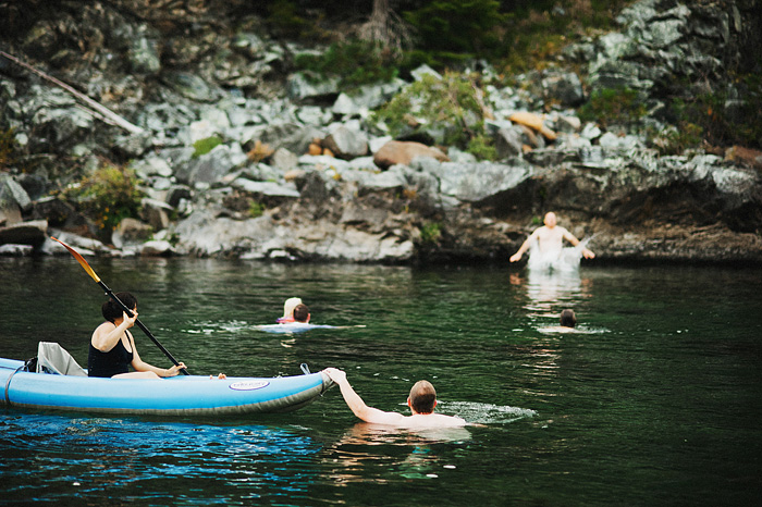 Groom watches brother leap into the Smith River - Intimate Backyard Wedding - Gasquet, CA