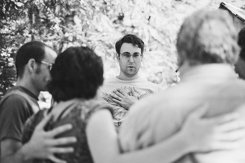 Salem Wedding Photographer - Groom saying ohms during group yoga - Jawbone Flats - Opal Creek Ancient Forest