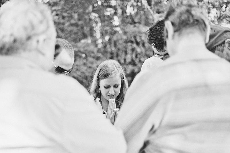 Salem Wedding Photographer - Group Yoga - Bride saying ohm before ceremony in Opal Creek Wilderness