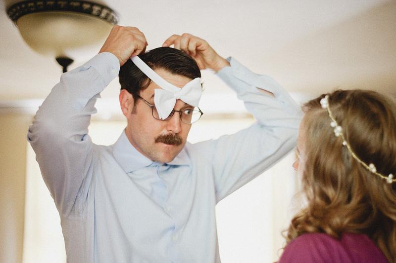 Multnomah Courthouse Wedding Photographer - Groom putting on bowtie