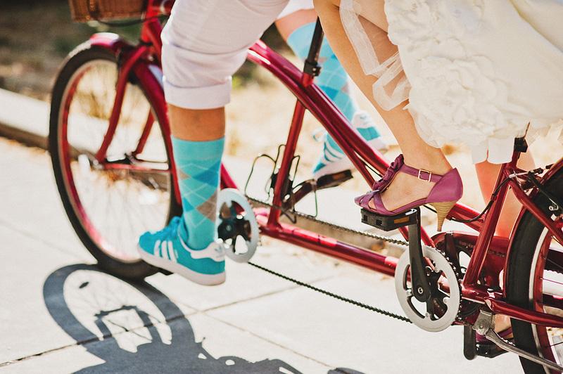 Portland Wedding Photographer - Bride and Groom on tandem bicycle - Portland bike parade wedding