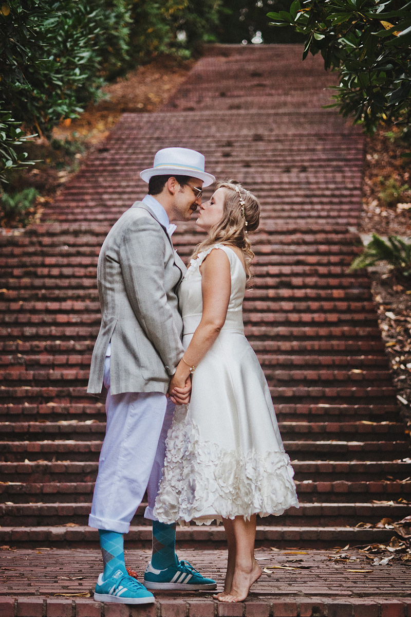 Multnomah Courthouse Wedding Photographer - Bride kissing Groom - Laurelhurst Park Wedding Reception