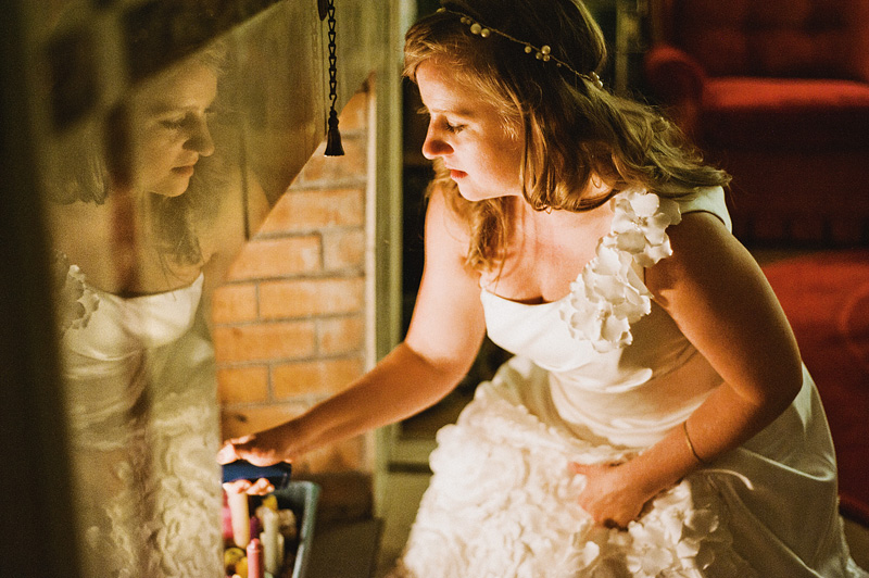 Multnomah Courthouse Wedding Photographer - Bride lighting candles in fireplace