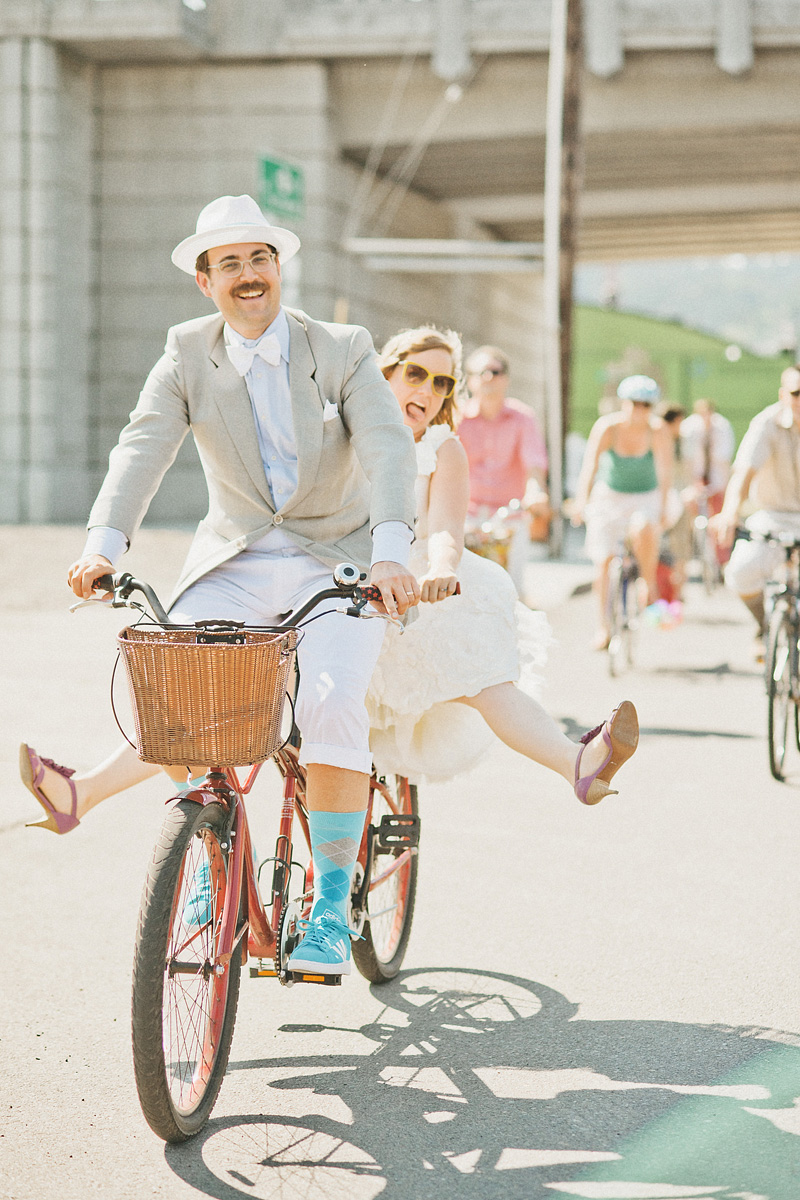 Multnomah Courthouse Wedding Photographer - Bride and Groom riding a tandem bicycle - Portland Bike Parade Wedding