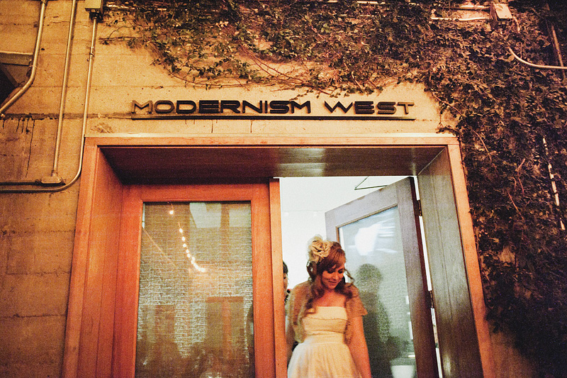Documentary San Francisco Wedding Photographer - Bride walking out of Modernism West - Wedding Reception at Foreign Cinema