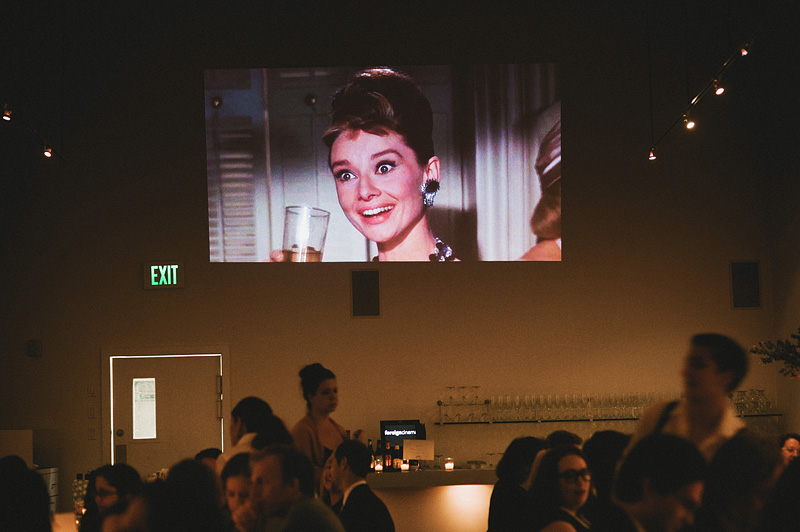 Movie projecter showing Breakfast At Tiffany's - Wedding Reception at Foreign Cinema