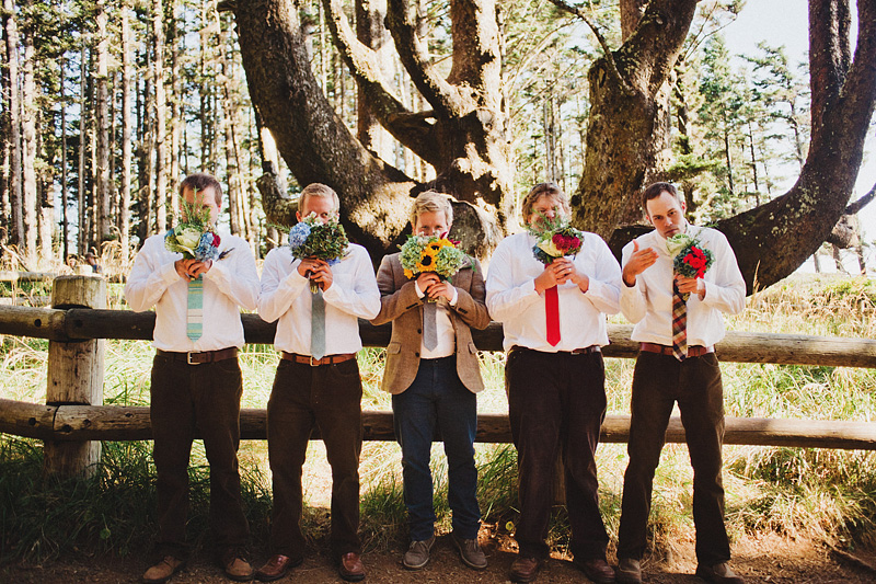 Cape Meares Wedding Photographer - Groomsmen holding bouquets at the Octopus Tree