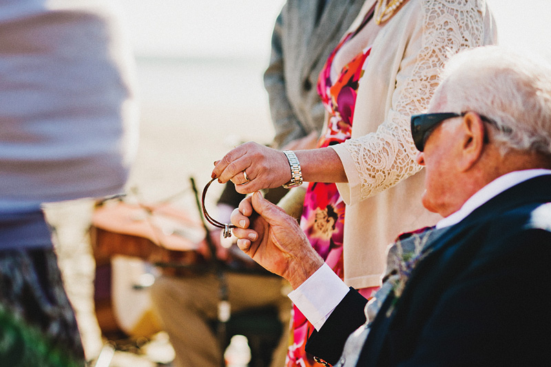 Tillamook Wedding Photographer - Family members blessing the wedding rings - Oceanside Beach Ceremony