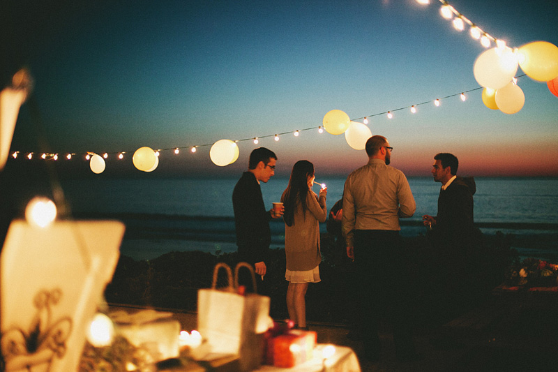 Tillamook Wedding Photographer - Guests smoking at sunset - Oceanside Community Center reception