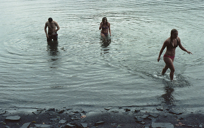 Portland Film Photographer - Bob, Miriam and Molly swimming during a thunderstorm