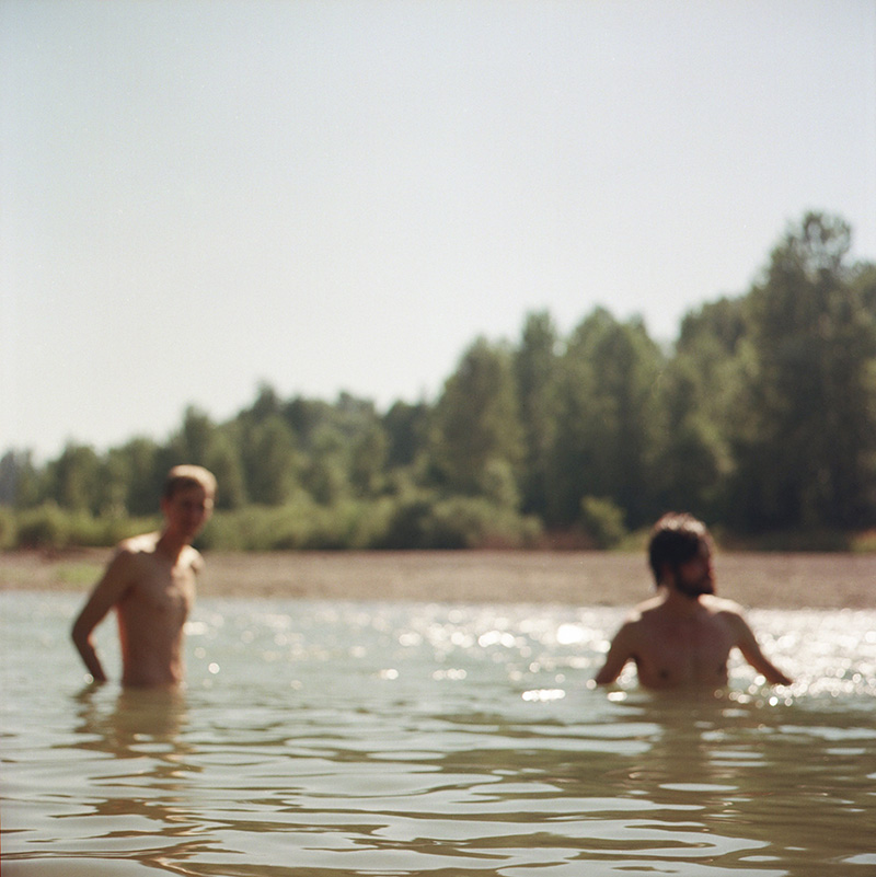 Portland Film Photographer - Out-of-focus shot of Chris and Mark in the Sandy River
