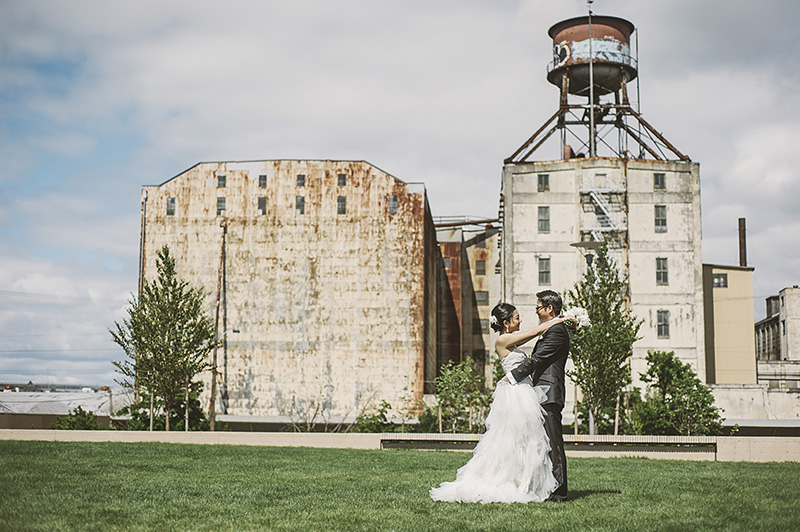 Oregon Wedding Photographer - Couple standing next to watertower in Fields Neighborhood Park