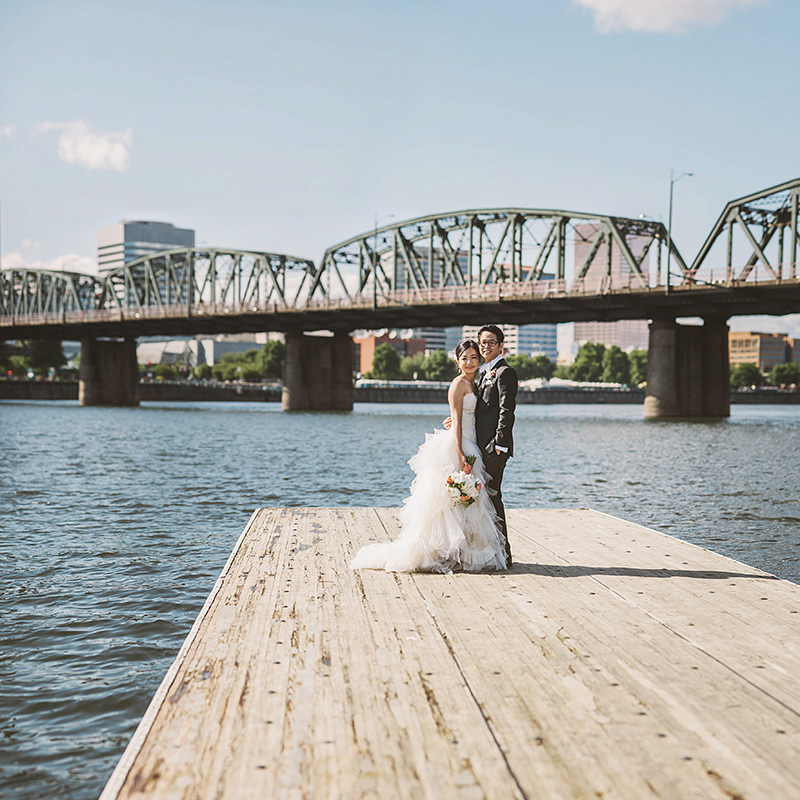 Oregon Wedding Photographer - Eve and Green standing on the Eastbank Esplanade near the Hawthorne Bridge