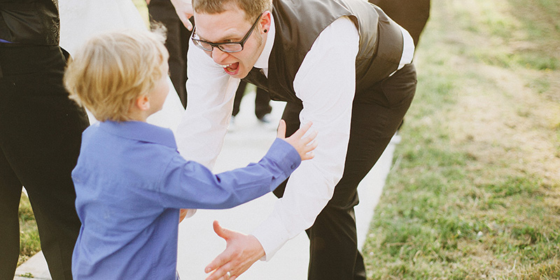 Arcata Wedding Photographer - Groom hugging the ring bearer