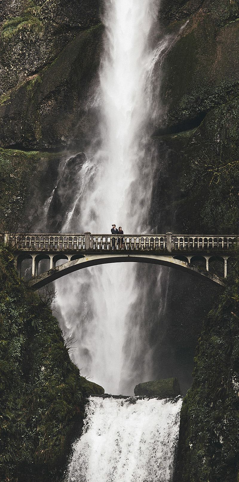 Multnomah Falls Wedding Photographer - Karen and Josh on a bridge, with the waterfall behind them