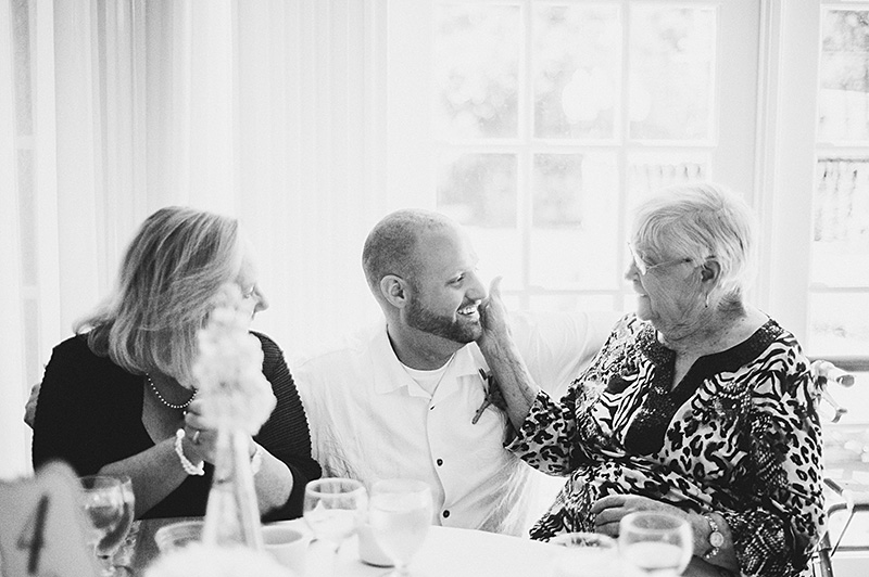 Sacramento Wedding Photographs - Groom talking with grandma