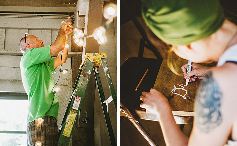 Guests stringing lights and handpainting signs | Kate & Will's Camp Seely Wedding | Kim Smith-Miller