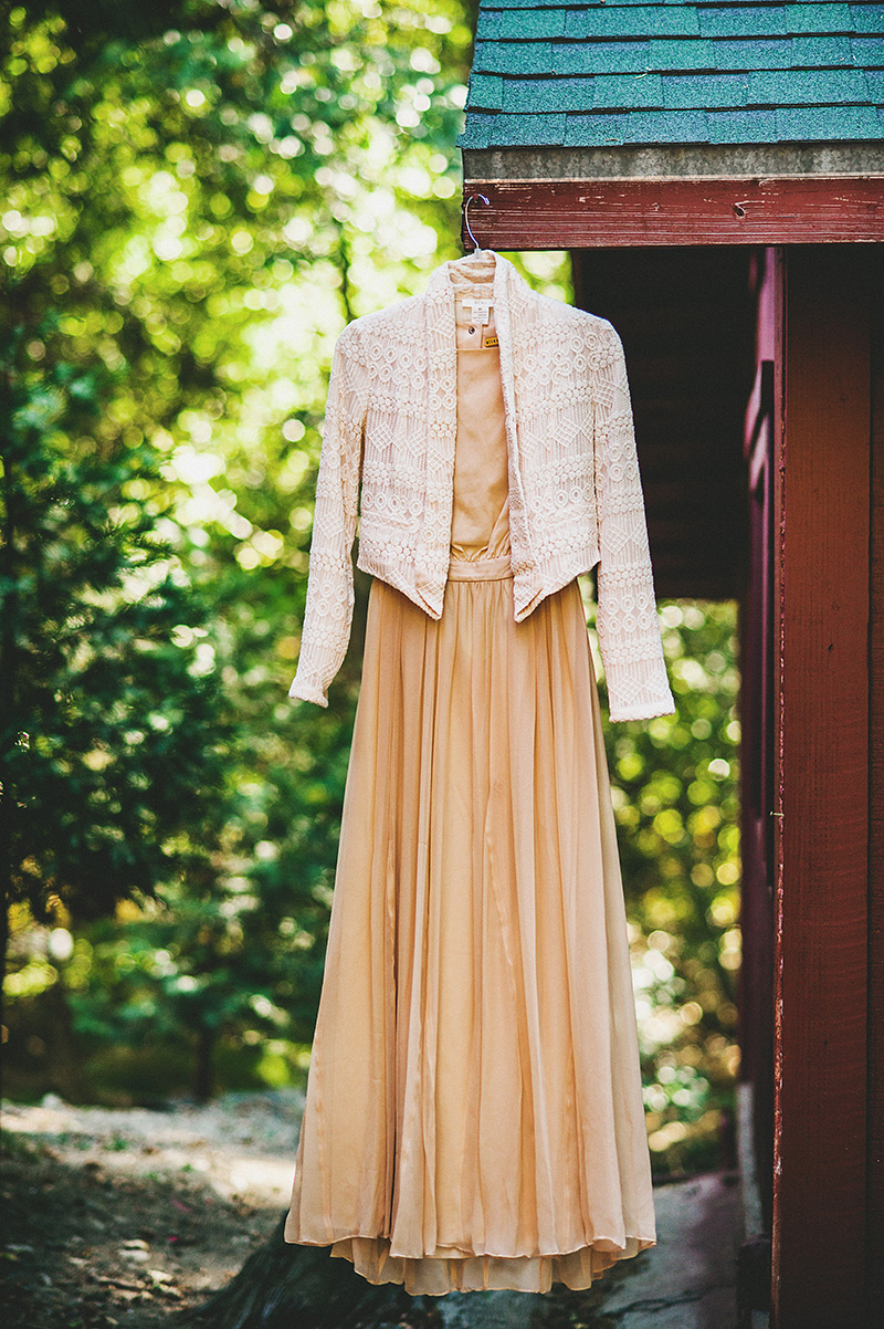 Bride's dress hanging from a cabin | Kate & Will's Camp Seely Wedding | Kim Smith-Miller
