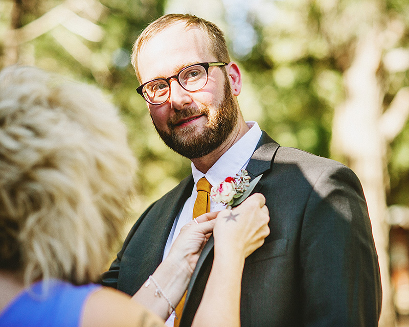 Bride's mother pinning the groom's boutonniere | Kate & Will's Camp Seely Wedding | Kim Smith-Miller