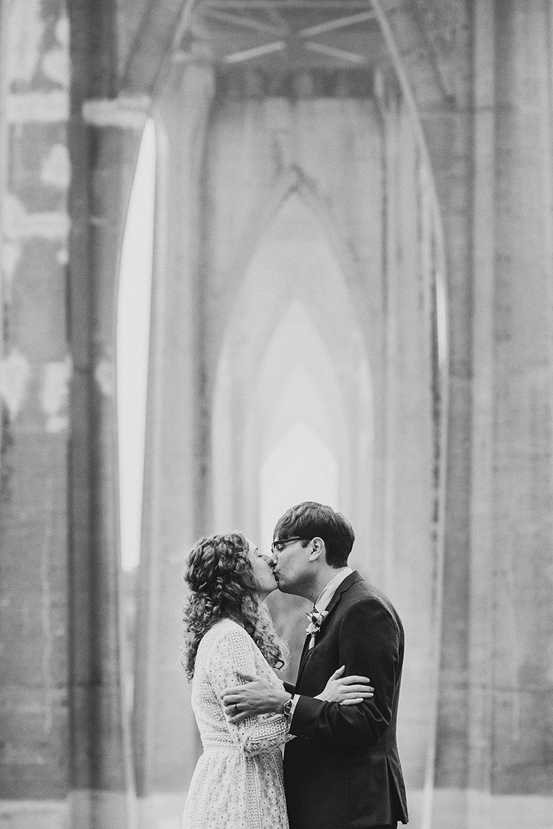 Bride and Groom kissing at their Cathedral Park Elopement in Portland, OR