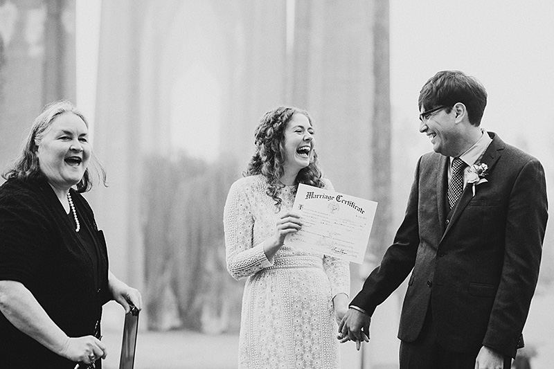 Bride and Groom presented Marriage Certificate at their Cathedral Park Elopement in Portland, OR