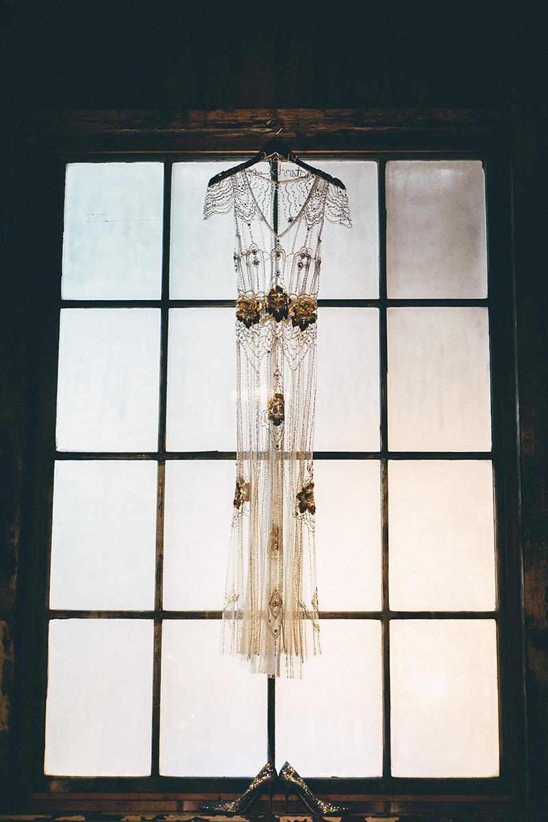 Bride's dress hanging in a window - Sodo Park Wedding Photographer