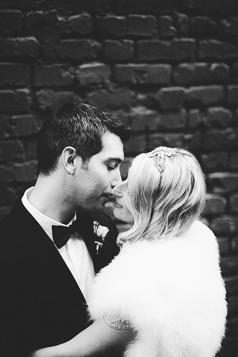 Bride and Groom kissing in the courtyard - Sodo Park Wedding Photographer