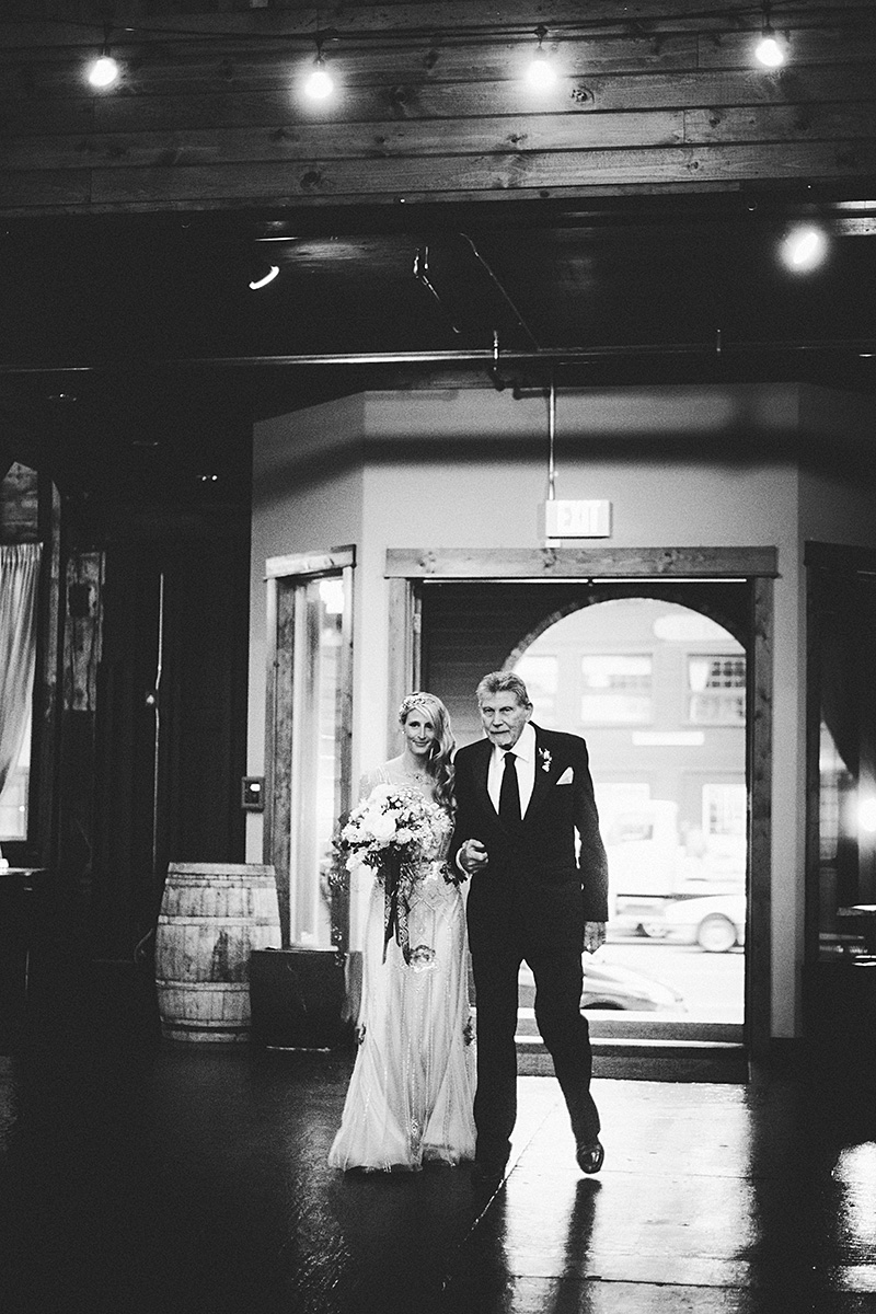 The bride walking down the aisle with her grandfather - Sodo Park Wedding Photographer