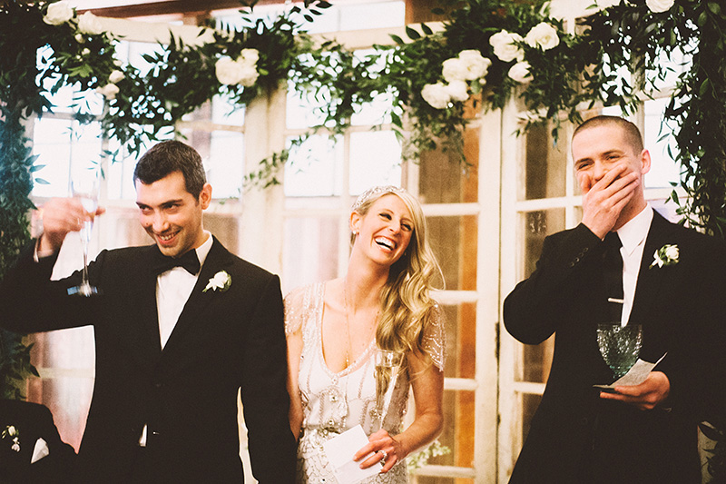 Bride and groom laughing over toasts - Sodo Park Wedding Photographer