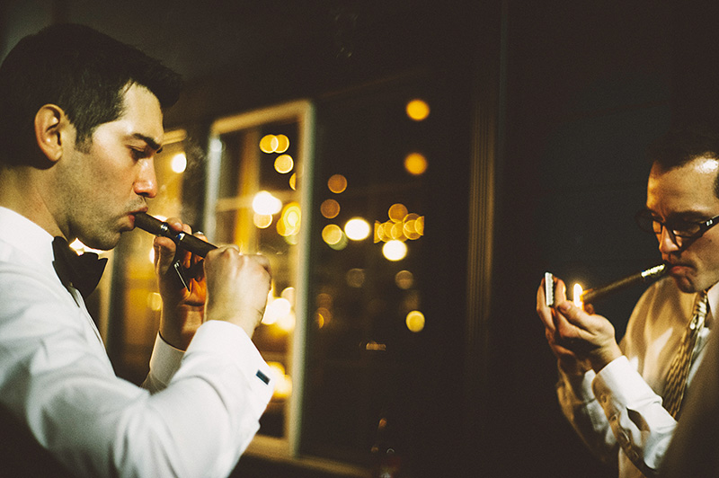 Groom and Groomsmen smoking cigars in the courtyard - Sodo Park Wedding Photographer