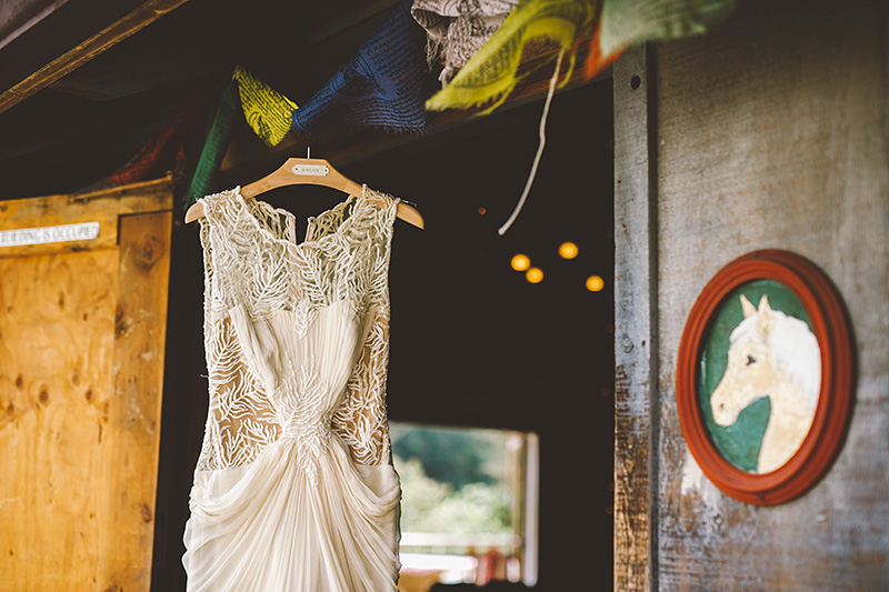 Bride's dress hanging in the Lucky Barn - Pendarvis Farm Wedding