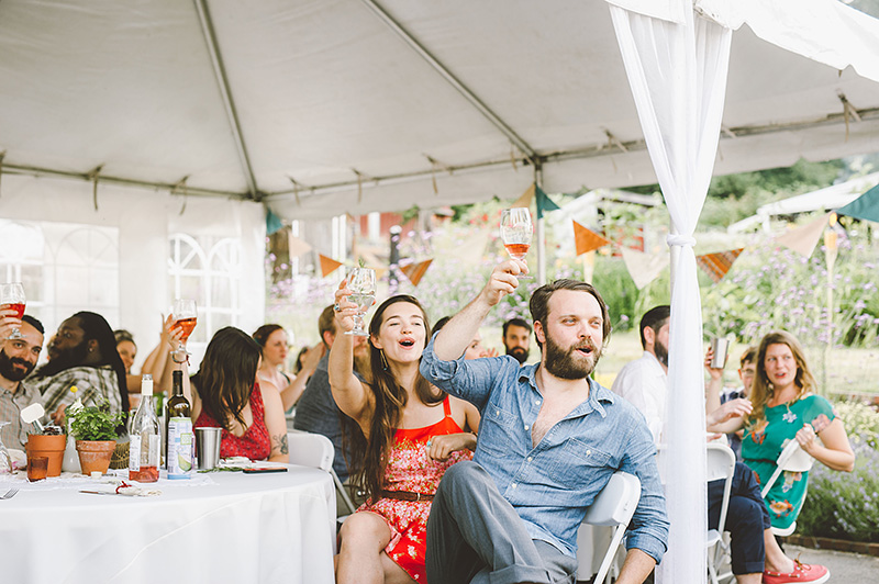 Guests cheering during toasts - Pendarvis Farm Wedding