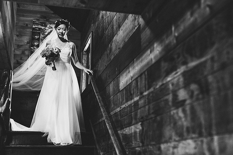 Bride walking down stairs at her Nature Bridge Wedding