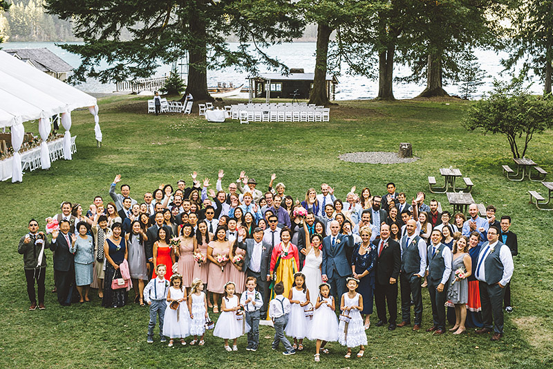 Group photo of all the guests from this Nature Bridge Wedding