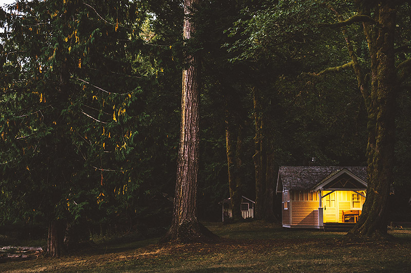 Cabins with the lights on at night |  Nature Bridge Wedding